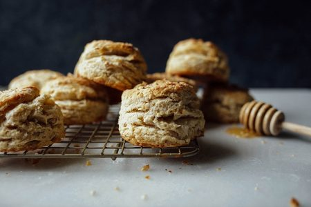 Honey Nut Biscuits Recipe by The Wood and Spoon Blog. Flaky butter biscuits sweetened naturally with honey and filled with nuts like pecans or walnuts. This simple recipe makes biscuits with lots of layers and doesn't require laminating. Recipe and other Mother's Day breakfast in bed menu inspiration on thewoodandspoon.com // woodandspoon.com