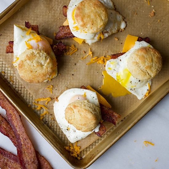 Buttermilk Biscuits and Pepper Bacon Egg and Cheese Biscuit Sandwiches. Flaky, all butter, Southern style biscuits with tons of layers topped with peppery bacon, cheddar cheese and a fried or scrambled egg. These breakfast sandwiches are perfect for the morning or brunch hour and makes a simple breakfast for the man / men in your life this Father's Day. Take these sandwiches on the go! Recipe by thewoodandspoon.com