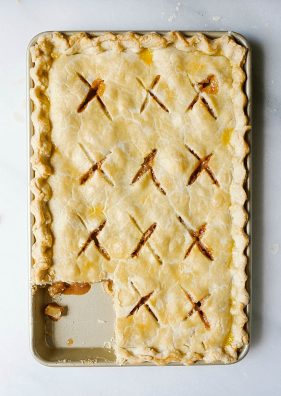 "Caramel Apple Slab Pie Recipe by The Wood and Spoon Blog by Kate Wood. This is a pie recipe prepared in a jelly roll pan, quarter sheet pan, or a 9""x 13"" pan. Filled with tart autumn apples and a salted caramel sauce inspired by bobby flay, fall dessert is perfect for serving a crowd and can easily be made ahead. Find the details and how to make your own Thanksgiving inspired treat on thewoodandspoon.com"