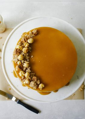 Brown Sugar Cheesecake with Oatmeal Cookie Crust and Butterscotch Sauce by The Wood and Spoon by Kate Wood. This is a creamy, almost caramel cheesecake made with brown sugar. The crust is a sweet and salty press-in crust made from oats. The whole thing is baked in a springform pan and topped with caramel corn and butterscotch sauce by Smitten Kitchen. Find the recipe and some tips on making a pretty cheesecake without cracks or soggy crust on thewoodandspoon.com