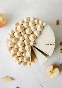 Maple Apple Cake Recipe By The Wood and Spoon Blog by Kate Wood. This is a 3 layer buttermilk cake filled with a bourbon apple pie filling, candied nuts, and maple brown sugar buttercream frosting. This is the perfect party cake for fall and is a great way to use up fresh apples. Get tips and how to on making stacking, frosting, and filling layered cakes. Find the recipe and inspiration at thewoodandspoon.com