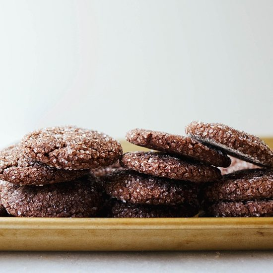 Mocha Cookies by Wood and Spoon Blog by Kate Wood. This is a coffee and chocolate lover's dream dessert! Soft and chewy chocolate crinkle cookies scented with espresso and made a little crunchy from the addition of sprinkling/ sanding sugar. This is a great cookie for cookie exchanges and holiday Christmas parties. Find the recipe and the how to for these baked good treats on thewoodandspoon.com