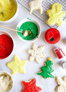 Soft Frosted Sugar Cookies recipe by Kate Wood of The Wood and Spoon blog. These are an old fashioned recipe handed down to me for soft and fluffy cutout Christmas cookies. These cookies hold their shape well and are perfect for decorating with buttercream style frosting. Host a cookie exchange or decorating party with these cookies that look great with sprinkles and other piped frosting. Find the recipe and how to for these holiday favorites on thewoodandspoon.com