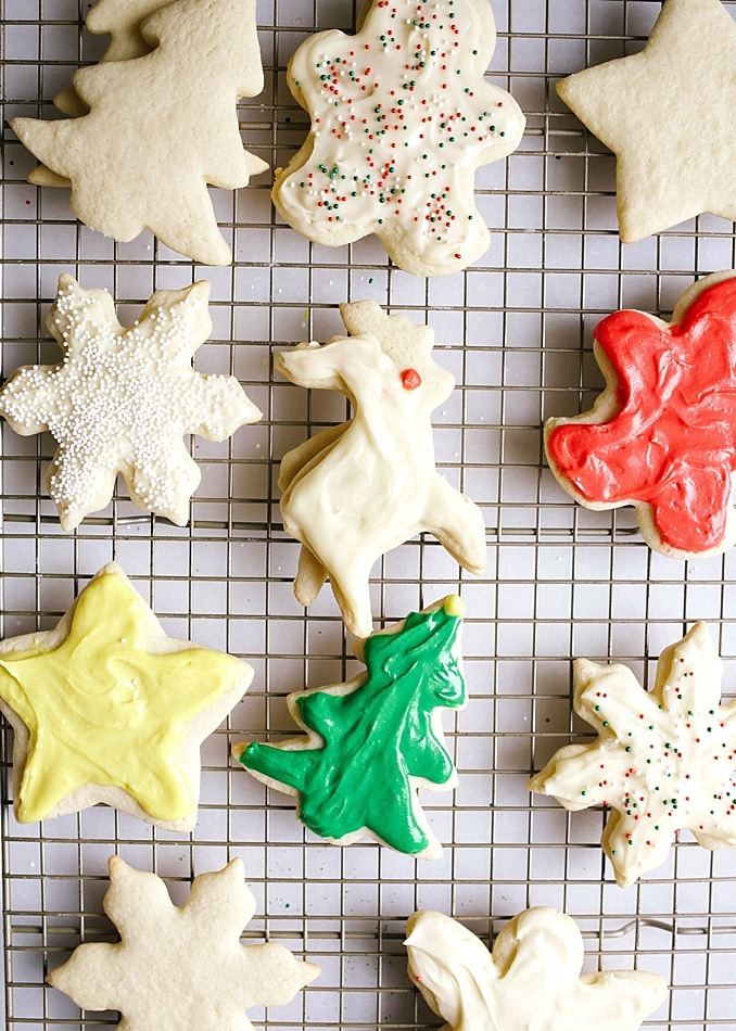 Soft Frosted Cutout Cookies recipe by Kate Wood of The Wood and Spoon blog. These are an old fashioned recipe handed down to me for soft and fluffy cutout Christmas cookies. These cookies hold their shape well and are perfect for decorating with buttercream style frosting. Host a cookie exchange or decorating party with these cookies that look great with sprinkles and other piped frosting. Find the recipe and how to for these holiday favorites on thewoodandspoon.com