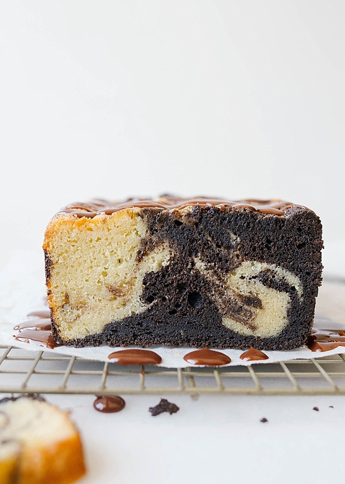 Marble Loaf Pound Cake by The Wood and Spoon blog by Kate Wood. This is a moist and rich recipe for pound cake inspired by the chocolate marble loaf cake at Starbucks! This makes one big bread loaf that is perfect for breakfast or dessert. The recipe is topped with a chocolate ganache glaze. The vanilla and chocolate batter is swirled together to give a marbled look! Find the recipe for this southern style buttermilk pound cake on thewoodandspoon.com