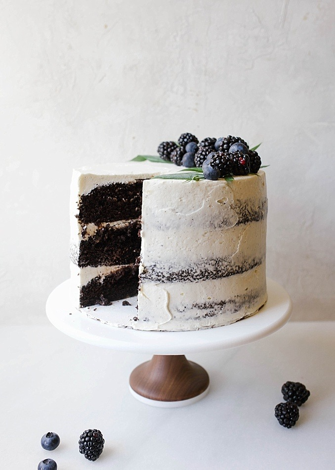 Black and White Cake By Wood and Spoon Blog by Kate Wood. This is a dark chocolate cocoa powder cake, made easily in one bowl, layered with a cooked flour vanilla bean frosting and a blackberry and dark chocolate ganache. This is a layer cake that is stunning and can even be used as a party/ wedding cake. The berry ganache is made with jam and cream. The cake is moist and fluffy, incredibly simple, and the frosting and smooth, light, and creamy cloud like. Find the recipe and the how to on thewoodandspoon.com