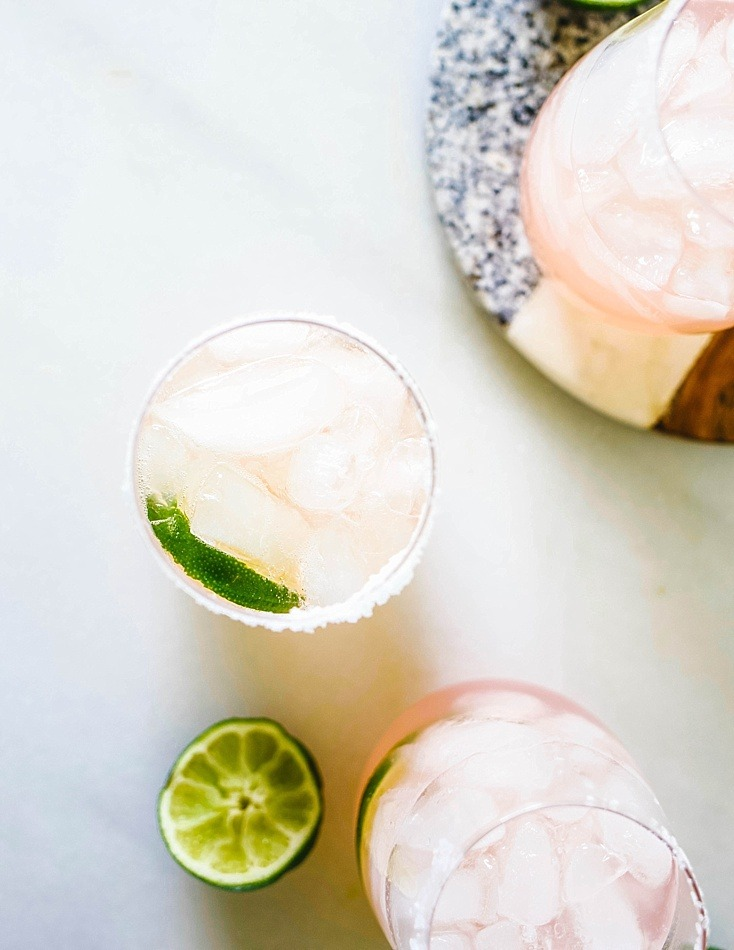 Rosé Margaritas By Wood and Spoon blog. These rose margaritas contain just a few ingredients- tequila, simple syrup, fresh lime juice, and rose wine. Simple to make and easy to batch for a large crowd, these refreshing summer beverages are the perfect way to celebrate cinco de mayo or other poolside fiesta. Find the recipe on thewoodandspoon.com!