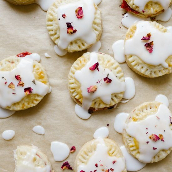 Raspberry Champagne Pop-Tart by Wood and Spoon Blog. These are simple homemade hand pies made with a raspberry champagne jam and a simple champagne glaze icing. Homemade pie dough makes little crimped round tarts that are filled with the simple cornstarch thickened jam. When cool, the desserts are topped with a frosting to sweeten the treats. Find the recipe and how to on thewoodandspoon.com by Kate Wood.