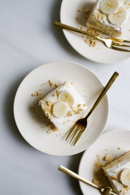 Banana Cream Pie Cake by Wood and Spoon blog. This. recipe is a fluffy white sponge cake topped with a vanilla pudding pastry cream, fresh bananas, and whipped cream! Finishes with a sprinkle of nuts, this cake is all your favorite pie flavors rolled into a sheet cake! Serves a crowd and semi make ahead too! Learn more about this southern cake on thewoodandspoon.com
