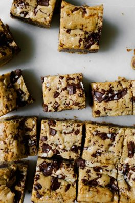 Brown Butter Muscovado Chocolate Chunk Cookie Bars Recipe by wood and Spoon blog. This is a recipe from displaced housewife new book. Chewy, sweet and salty blondies made with rich caramel tasting sugar and dark chocolate. Sea salt finishes these bars that make great dessert, tailgate and party snacks, or late night treats. Find the simple how-to on thewoodandspoon.com by Kate wood.