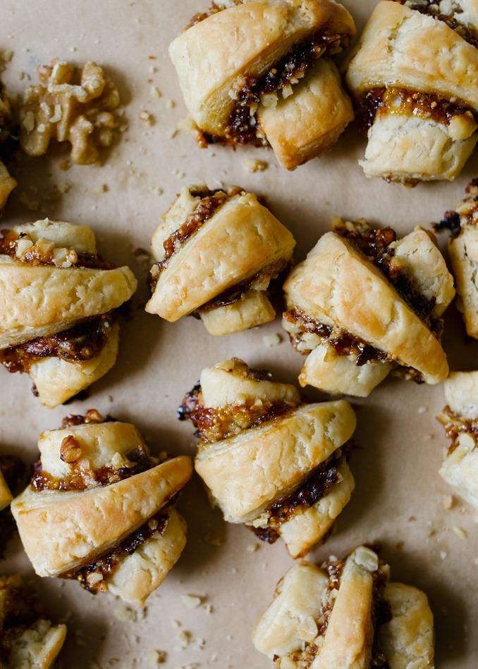 Sweet and Savory Rugelach by Wood and Spoon blog. These are traditional rugelach cookies made two ways: one with a blue cheese, fig spread, and Diamond Walnuts filling, and another made with white chocolate and Marcona almonds. The savory cookie is a perfect small bite appetizer for holiday gatherings and the white chocolate one is a decadent dessert. The pastry here flakes up and crisps almost like pastry dough. Try these yummy holiday treats with the recipe on thewoodandspoon.com