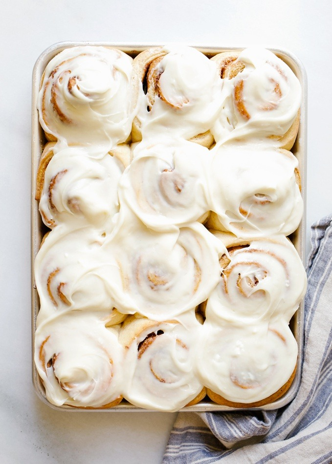Overnight Cinnamon Rolls by Wood and Spoon. These are fluffy brown sugar and spice morning buns topped with a cream cheese frosting. The yeast dough can be prepped ahead of time, rolled, and left to rest in the fridge until baking time the following morning. This recipe makes delicious breakfast treats a cinch and is perfect for holiday entertaining. Find the recipe and how to for these pastries on thewoodandspoon.com by Kate Wood