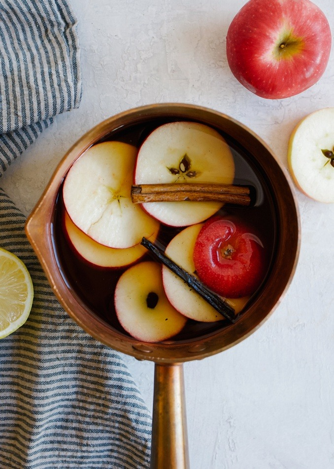 Warm Apple Tea recipe by wood and spoon blog. This is a sweet tea based winter beverage infused with fresh apples, cinnamon, vanilla bean, and served with lemon. This drink feels like a caffeinated cider, warm and toasty, the perfect beverage for chilly mornings. This is made with ready to drink Red Diamond sweet tea and can be refrigerated and served cold as well. Make a large batch and reheat all week long! Find this alternative to coffee and hot tea recipe on thewoodandspoon.com by Kate Wood