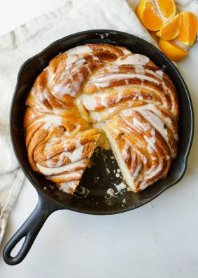 Orange Swirl Bread by Wood and Spoon blog. This is a cinnamon- swirled yeast bread twisted with orange zest and drizzled with orange glaze. Served warm, this is an excellent breakfast treat but is also perfect for nibbling on at dessert. This bread is a baking challenge and a fun way to learn more about baking! Read more about this citrus cold-weather recipe on thewoodandspoon.com by Kate Wood