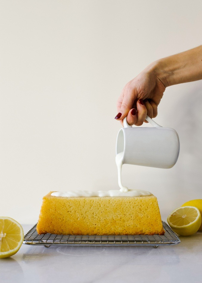 Lemon Pound Cake recipe by Wood and Spoon blog. This is a southern style pound cake loaf scented with lemon juice and zest and topped with a sweet and tangy lemon glaze. This recipe makes one loaf or three mini loaves of bread. This baked good can double as dessert or breakfast! Sweet, tart and beautifully yellow, this pound cake can be cut and served in trifles or stand alone. Find the recipe and read more at thewoodandspoon.com by Kate Wood