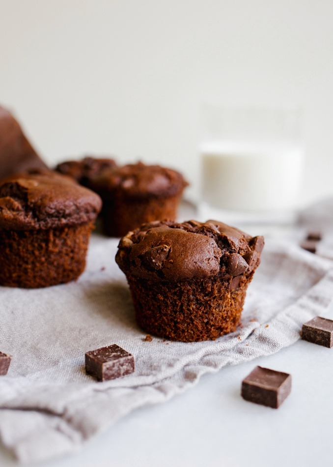 Double chocolate muffins by wood and spoon blog. These are a one-bowl recipe loaded with cocoa powder and chocolate chips. These are a simple make ahead valentines breakfast in bed option and freeze well for treats to save for later! Check out the recipe and how to for the moist cupcake like pastries on thewoodandspoon.com by Kate wood.