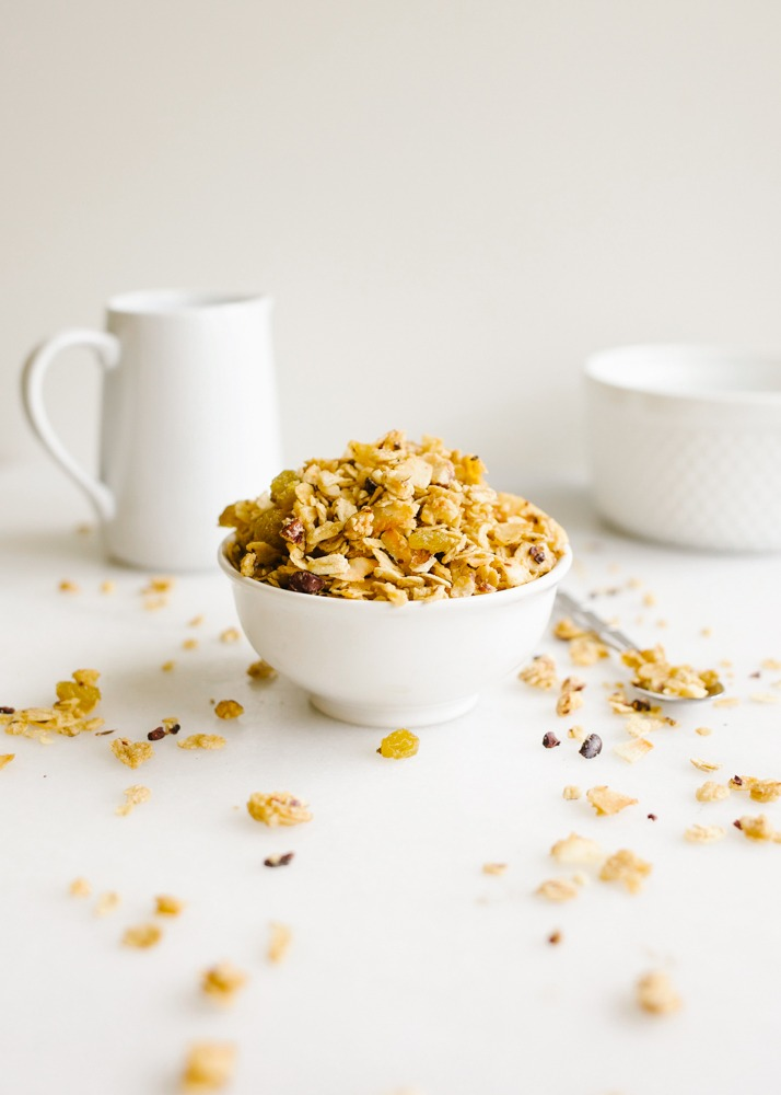 Eleven Madison Park Granola Copycat Recipe and what to do in New York city foodie guide by Wood and Spoon Blog by Kate Wood. This is a healthy Rolled oat based recipe from NYC famous restaurant. Filled with chopped hazelnuts, cacao nibs, golden raisins, and flaked coconut chips, this is a sweet and salty delicious and easy granola. Tossed in a brown sugar, maple syrup, and olive oil based glaze. It keeps fresh and makes a wonderful food gift to share. Find the recipe and step by step how to on thewoodandspoon.com
