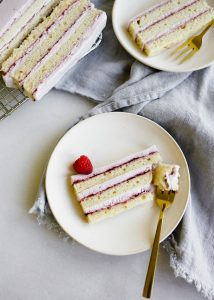 Lemon Lavender Icebox Cake by Wood and Spoon. This is a lemon layer cake frozen with lavender whipped cream and a raspberry preserve filling. The cake can be made ahead of time in advance and serves a crowd. Perfect springtime treat for easter dessert or mothers day. This cake can be made rectangle or square or round and is way more simple that is looks! Get the how to on infusing lavender into food and makes a soft and fluffy citrus cake. Recipe by Kate wood thewoodandspoon.com