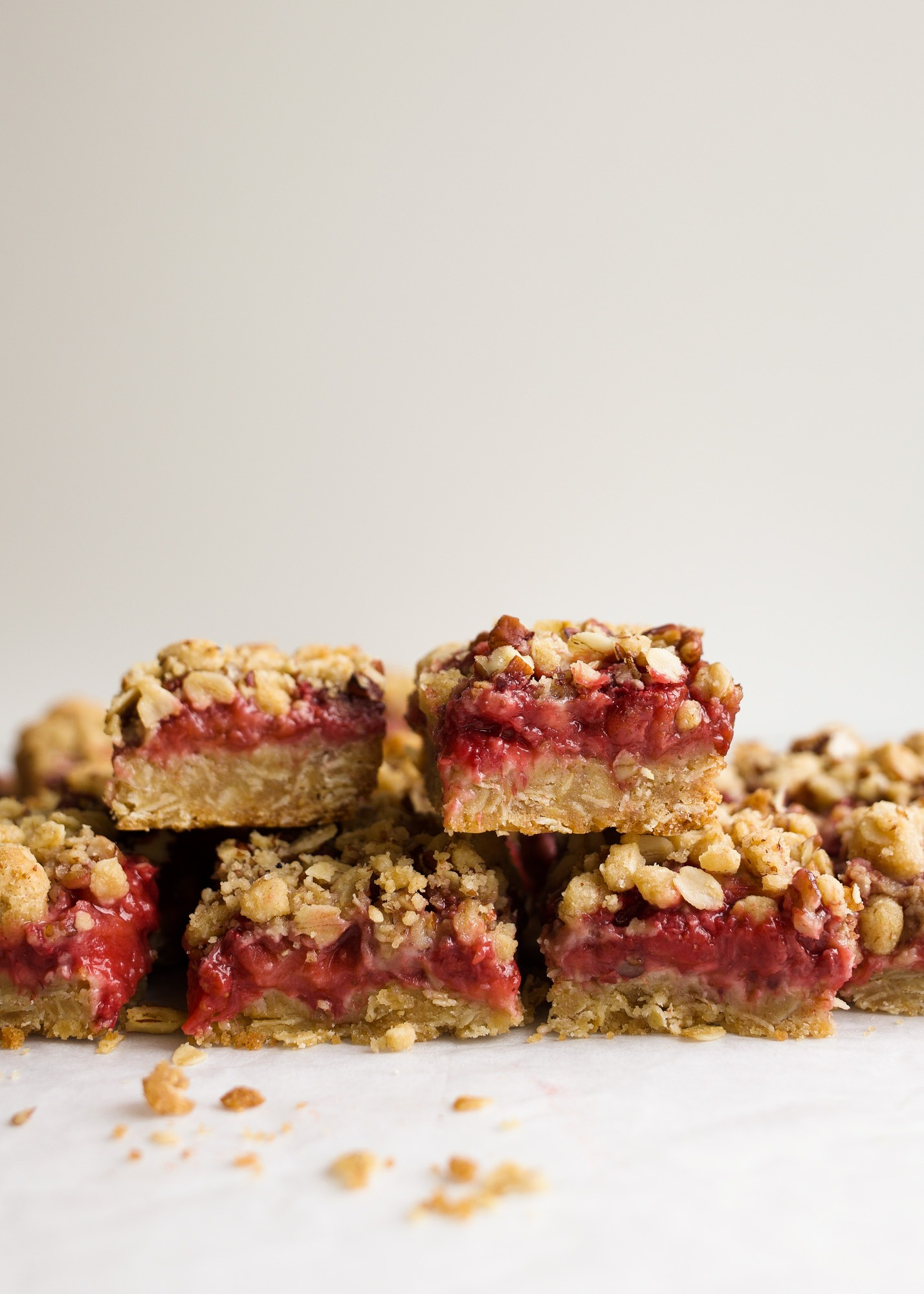 Strawberry Rhubarb Crumb Bars by Wood and Spoon blog are simple, make ahead jam filled bars made from spring fruit. The tart rhubarb makes a quick preserve with strawberries for a gooey centered oatmeal cookie bar. You can use fresh or frozen fruit for the jam and add additional fruit to make extra thick and fruity bars. Check out the recipe and how-to on thewoodandspoon.com