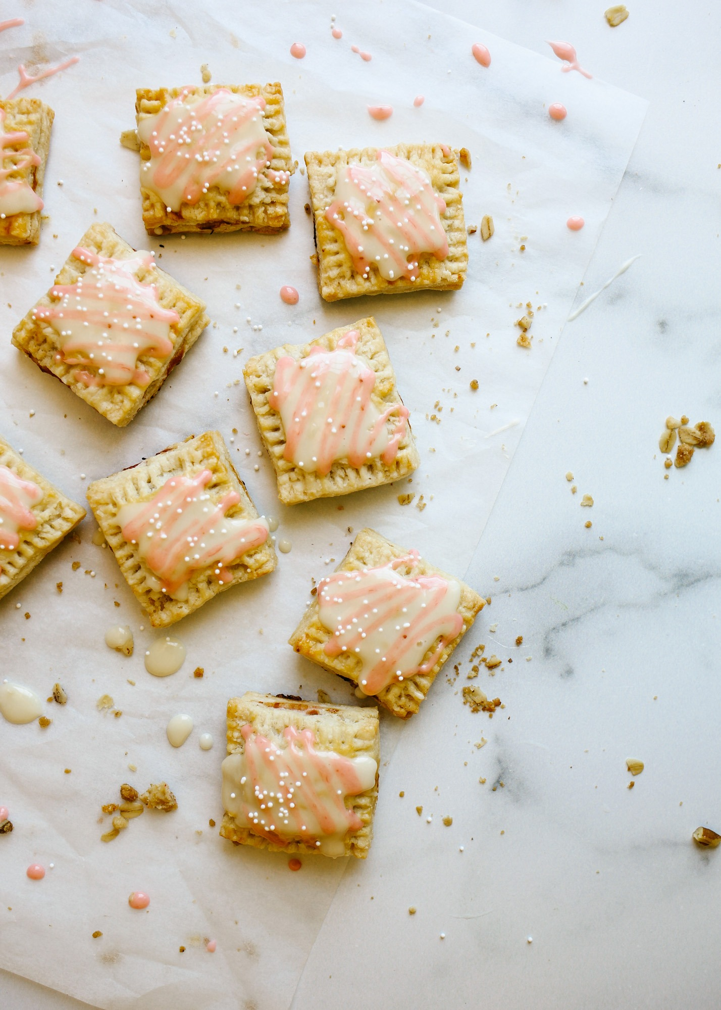 Rhubarb Pop-Tarts by Wood and Spoon blog. This recipe is for mini square hand pie breakfast pastries filled with a quite homemade rhubarb compote jam and a honey glaze icing. The hand pies can be made in advance and batches. These make fun morning treats or desserts. Learn how to DIY make from scratch pop-tarts here with simple pie dough and jelly on thewoodandspoon.com