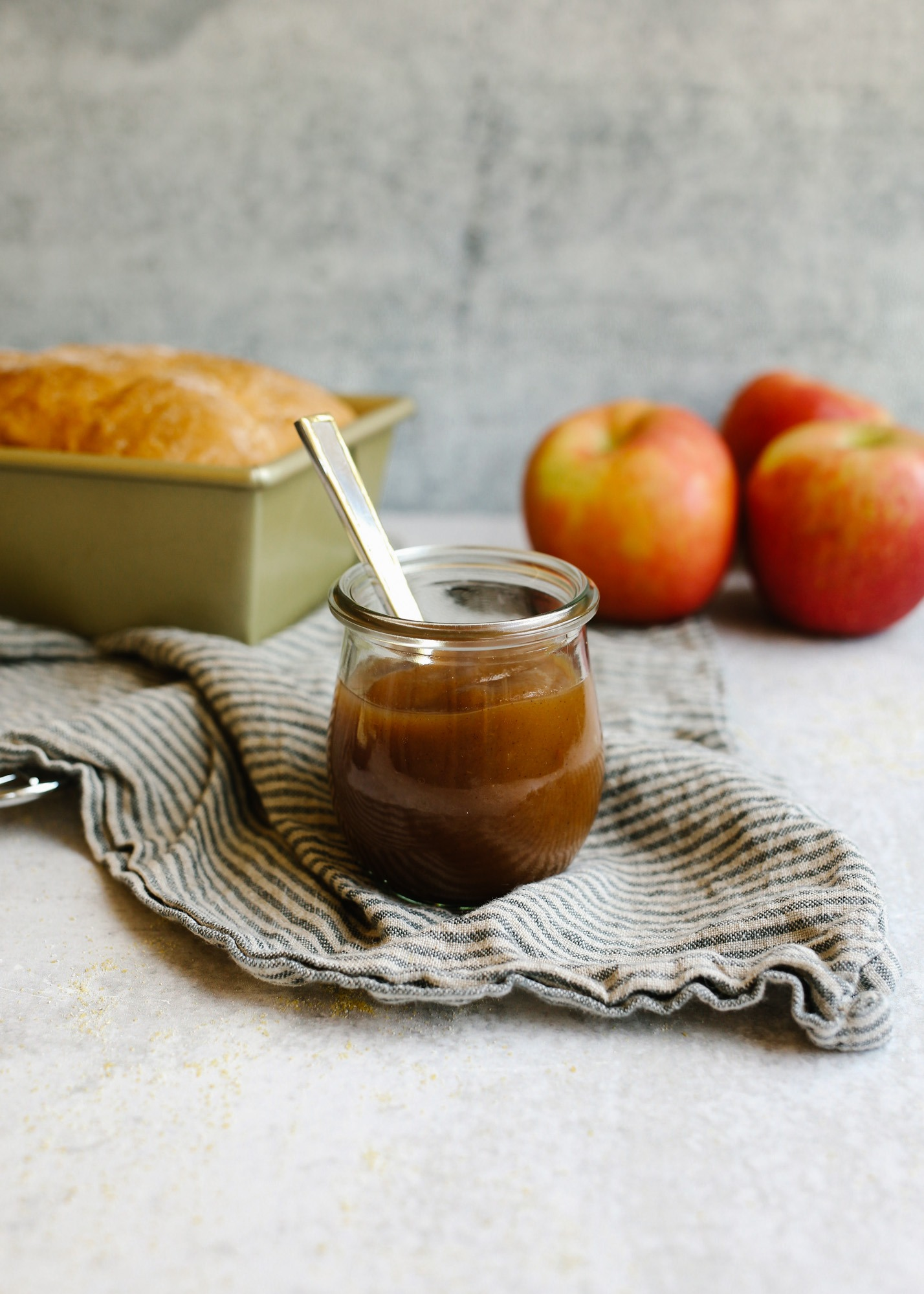English Muffin Bread and Apple Butter this simple no knead one bowl quick rise yeast bread is a loaf form of the classic breakfast dish. Serve it with homemade maple apple butter made in a slow cooker/ crock pot. This is a simple make ahead baked good perfect for the fall. Read more at thewoodandspoon.com