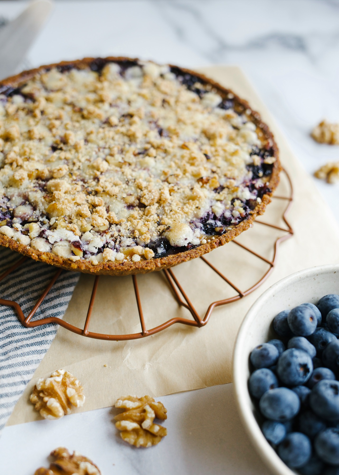 Blueberry Sour Cream Pie. This is a walnut pie crust made with a sweet sour cream filling and fresh cinnamon scented blueberries. The crumb topping adds flavor and texture as well as extra walnuts! Use a ready made crust and this simple pie has less than 10 ingredients and 10 minutes prep time. Find this simple summer recipe on thewoodandspoon.com