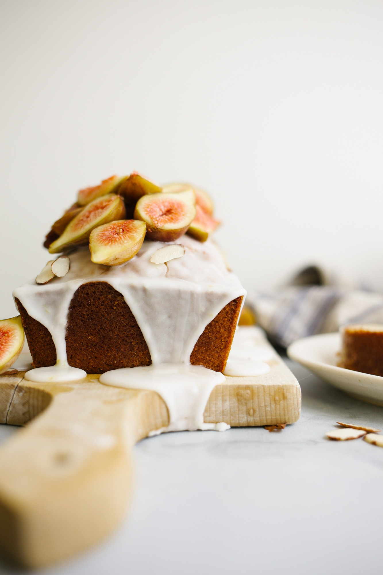Vanilla Butter Loaf by Wood and Spoon. This is a pound cake like cake with a cinnamon swirl and a simple vanilla glaze. Top with fresh seasonal fruit or eat plain! This make ahead treat is great to serve as a breakfast snack or dessert. Learn more about this easy baked good on thewoodandspoon.com