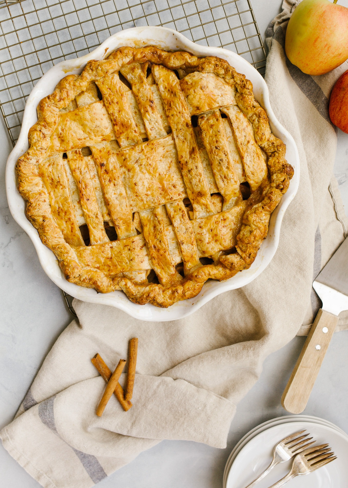 Cheddar Apple Pie by Wood and Spoon. This is an apple pie with an all-butter and cheddar cheese crust. The fruit filling is flavored with cinnamon and fall spices and is juicy. The cheddar crust is lightly flavored and flaky. Learn more about how to on this autumn lattice pie on thewoodandspoon.com