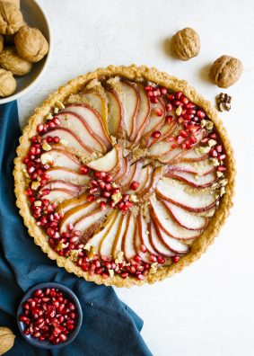 Brown Butter Pear Tart and our time in Boston and Martha's Vineyard. This is the recipe for a sweet pastry crust tart filled with brown butter custard and layered red pears. Fresh pomegranate top the pretty holiday dessert for a crowd. Can be served at room temperature and made ahead. Read more about our trip to new England coast to Martha's Vineyard and historical Boston with this foodie guide of what to eat and see and do and where to stay. by wood and spoon blog by Kate Wood