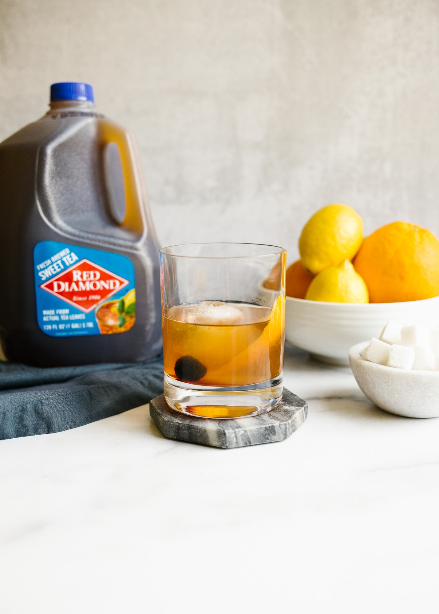 Sweet Tea Old Fashioned by Wood and Spoon. This is the classic Kentucky bourbon cocktail made with orange bitters, whiskey, and just a smidge of ready to drink sweet tea. Make this in a batch for friends as a party beverage or drink as a great end of day cocktail. This is a southern spin on the original drink! Read more on thewoodandspoon.com