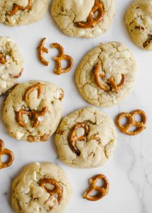 White Chocolate Caramel Pretzel Cookies by Wood and Spoon blog. These are white chocolate chip cookies filled with caramel bits and nibs and chunks of salted pretzels. These sweet and salty cookies make terrific group desserts for a crowd and are a delicious treat. Learn how to make these melted butter cookies with the recipe on thewoodandspoon.com by Kate Wood.