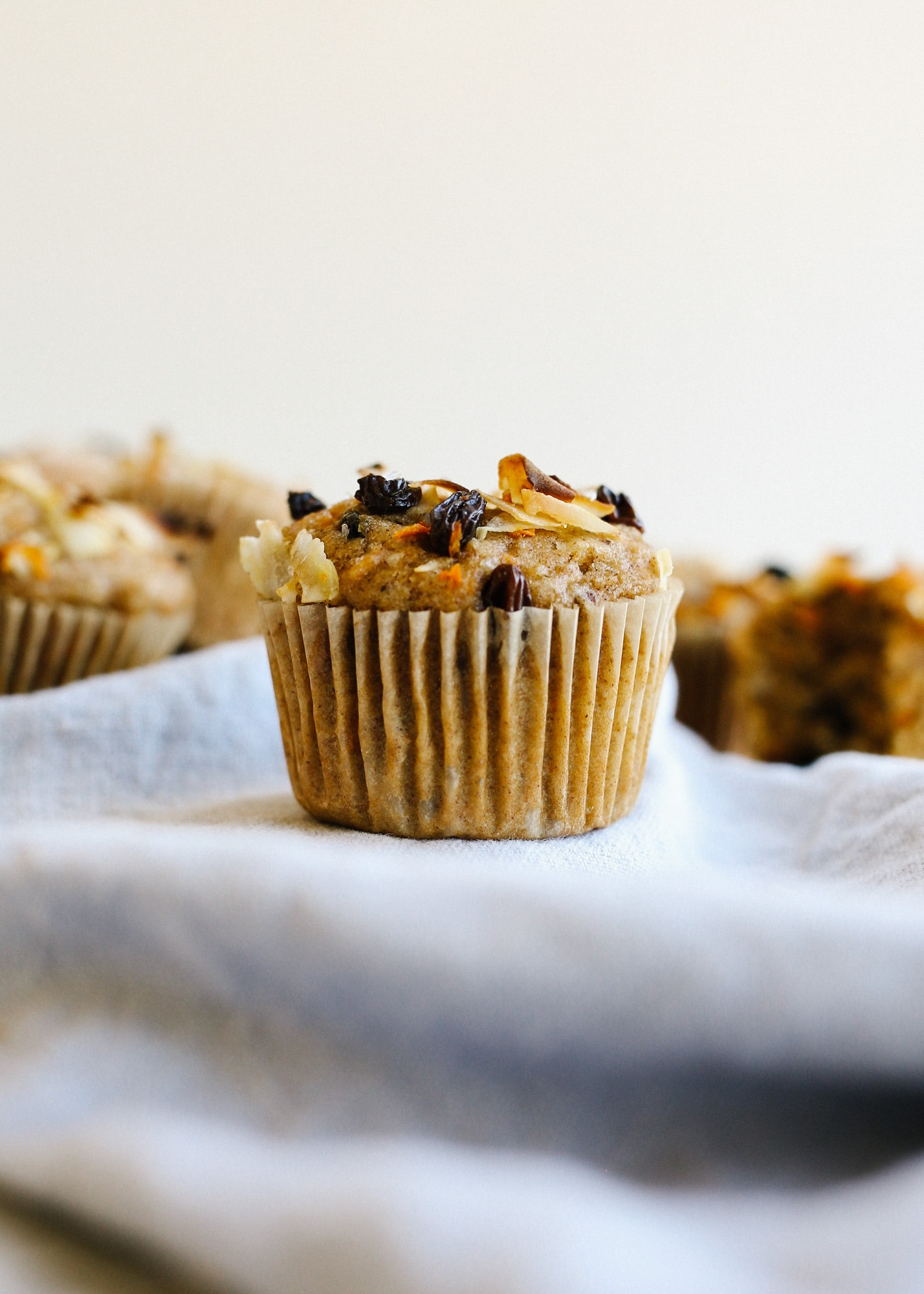 Morning Glory Muffins by Wood and Spoon Blog by Kate Wood. These are healthy muffins with natural sweeteners, whole wheat flour, and loads of carrots, coconut, and raisins. These are hearty breakfast pastries and afternoon snacks and make great little energy bites that are simple, make ahead, and easy to freeze. Learn more about the recipe on thewoodandspoon.com