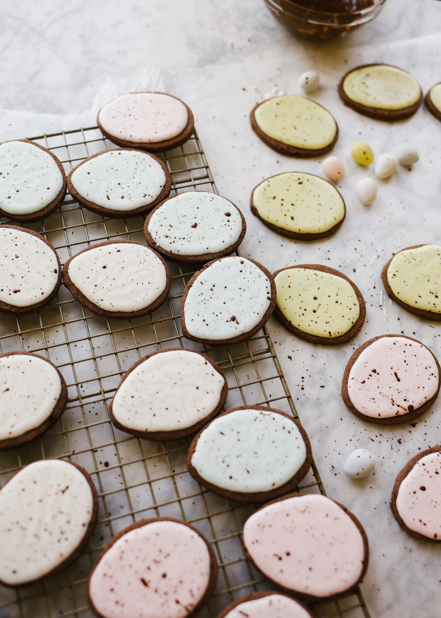 Chocolate Cutout Cookies (with Speckled Easter Egg Decorating Tutorial!) by Wood and spoon. These are cocoa powder and butter cutout cookies that are simple and don't require softened butter. You can make and freeze these in advance and the icing is simple. No royal icing- just a yummy one bowl glaze. This splattered robin egg decorating technique is a great edible easter craft for kids. Learn how to make these at home on thewoodandspoon.com
