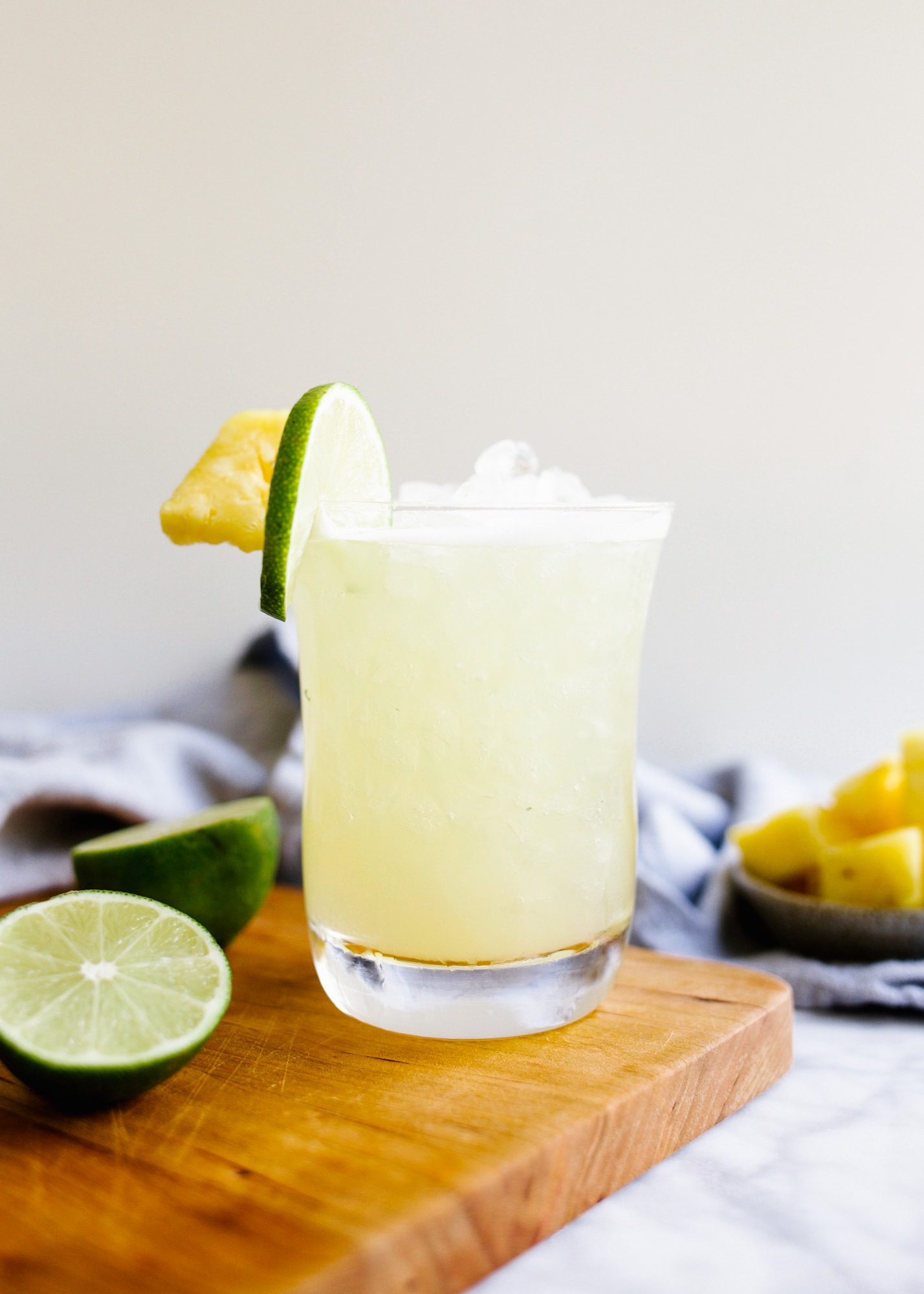 Pineapple Ginger Rum Punch by Wood and Spoon. Beachy flavors of pineapple, rum, lime, and ginger combine over ice to make a sweet and boozy beach day drink perfect for your summer days. Serve with a dollop of whipped cream and make a big batch to serve a crowd. Learn how to make this poolside cocktail on thewoodandspoon.com