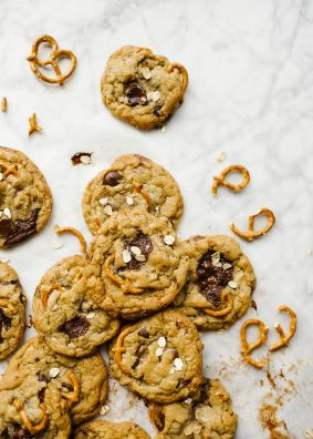 Kitchen Sink Cookies by Wood and Spoon blog. This is a catch-all chocolate chip cookie loaded with pretzels, toffee, oats and dark chocolate chunks and chips! The dough is adaptable and can be used with a number of other mix-ins: dried fruit, white chocolate, peanut butter chips, and more! This simple recipe comes together quickly, freezes well, and is a delicious chewy treat for all year round. Read more about the recipe on thewoodandspoon.com