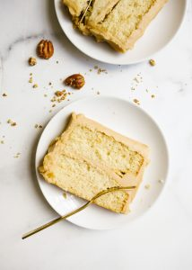 Bourbon Caramel Cake by Wood and Spoon blog. This is a fluffy brown sugar bourbon cake with a Southern old fashioned caramel frosting made with brown sugar. This is a small batch cake that only serves a few, perfect for weeknight baking. This rectangular cake makes sweet and salty layers that are perfect for fall and holiday baking. Learn how to make old fashioned icing on thewoodandspoon.com