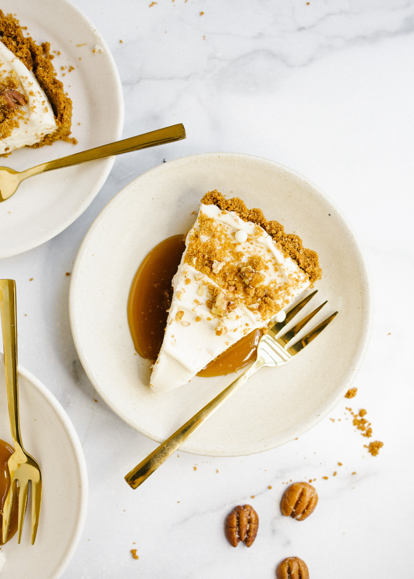 Maple Cream Tart by Wood and Spoon. This is a simple cream tart made with a biscoff cookie and pecan crust, a maple cream pie filling, and a homemade maple caramel. This sweet and salty holiday dessert can be made ahead and feeds a crowd. Learn how to make this beautiful fall dessert on thewoodandspoon.com