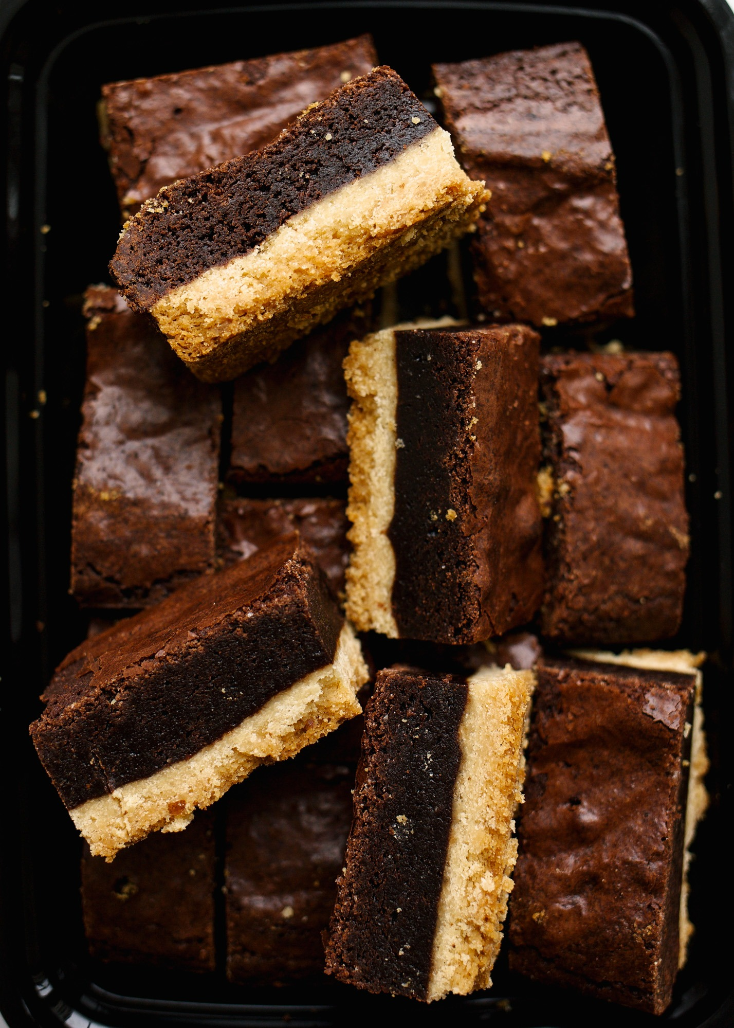Brownie Shortbread Bars by Wood and Spoon. These are two layer bars made of a buttery vanilla bean shortbread crust and a gooey crackly top brownie. The brownie is rich and fudge without being overly dark, and the crust is crisp and tender. These bars are perfect for the shortbread lovers or for brownie lovers who love a great deal of texture! Learn how simple they are to make on thewoodandspoon.com