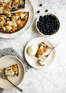 Berry Buckle by Wood and Spoon blog. This is a simple breakfast cake / dessert dotted with summer blackberries and blueberries and topped with an almond streusel. The cake bakes up well and is delicious served with whipped cream and ice cream. Learn how simple the recipe is at woodandspoon.com