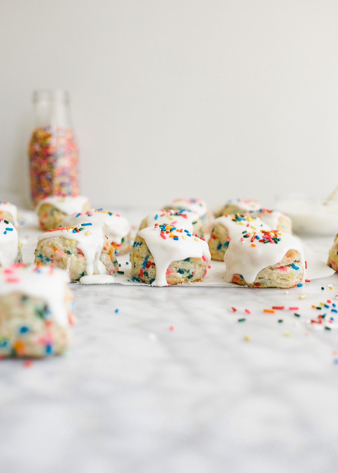 Funfetti Biscuits by Wood and Spoon blog. These are fluffy Southern Style buttermilk biscuits loaded with sprinkles, box mix cake flavor, and topped with a sweet and simple icing. There are tons of things to put sprinkles on and these sprinkle biscuits make for a fun and festive back to school breakfast. If you're looking for fun breakfast ideas for kids, look no. further than these sweet morning biscuits! The recipe and how to is on thewoodandspoon.com